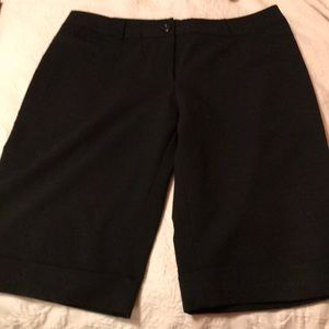 EUC.  Long black stretch shorts